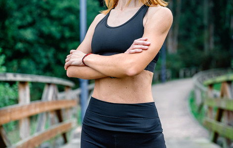 Athlete woman posing with arms crossed