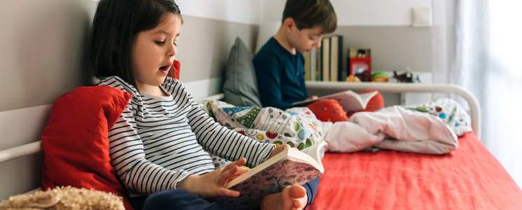 Girl and boy reading a book