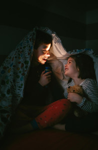 Boy telling a story to his sister
