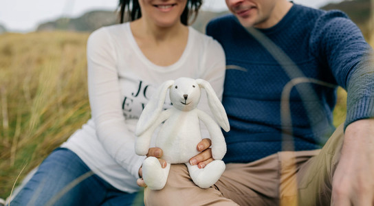 Couple showing a stuffed bunny