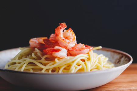 Fried shrimps on the pasta  The concept of dinner or lunch with seafood