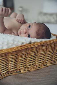 Baby lying in a wicker basket