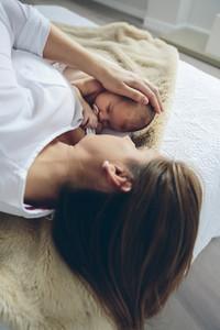 Mother hugging her newborn baby girl