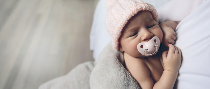 Baby girl with pacifier sleeping