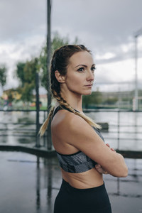 Sportswoman posing arms crossed