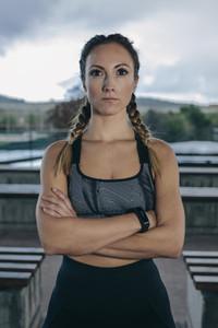 Sportswoman posing arms crossed