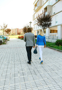 Businessman and businesswoman walking to their office