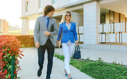 Businessman and businesswoman leaving the office