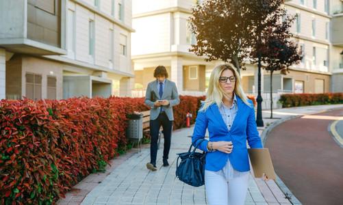 Businesswoman walking down the street to work