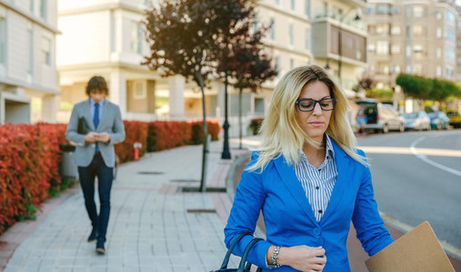 Businesswoman walking down the street to work