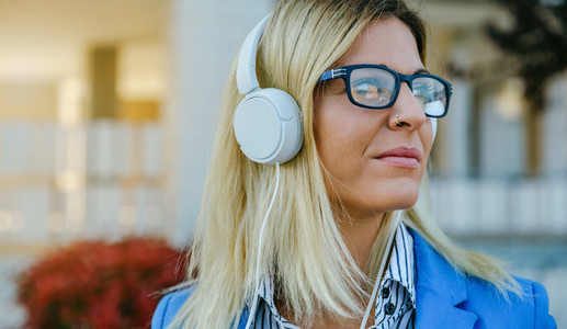 Businesswoman with nose piercing and headphones