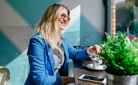 Working girl stiring coffee