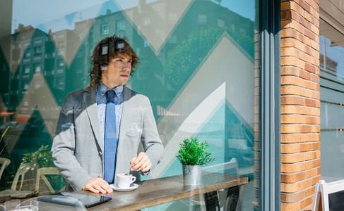 Businessman stirring coffee
