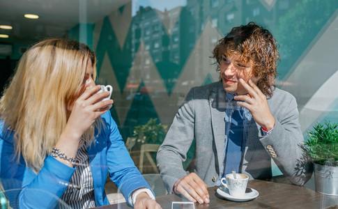 Coworkers flirting on coffee break