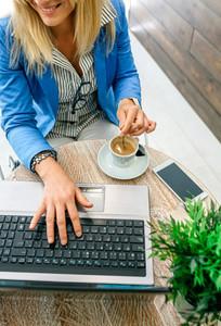 Businesswoman working during coffee break