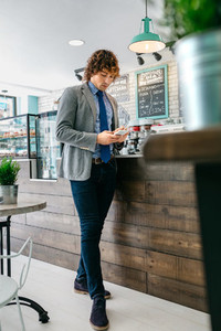 Businessman looking mobile in a cafe