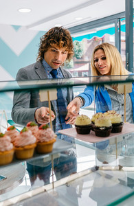 Couple choosing a cupcake