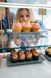 Couple choosing a cupcake