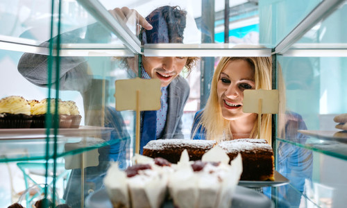 Couple choosing a cake