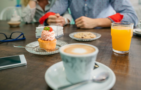 Breakfast with couple holding hands