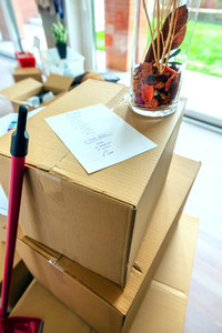 Stack of moving boxes with checklist