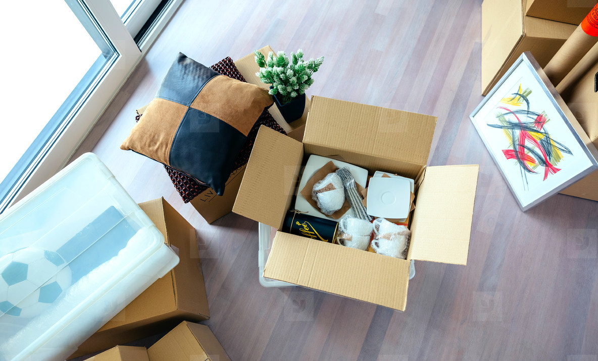 Living room with stack of moving boxes
