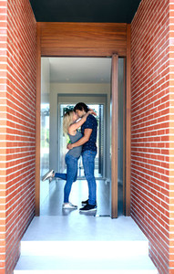 Couple kissing at the entrance