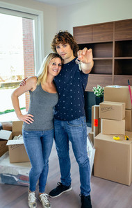 Moving couple showing keys