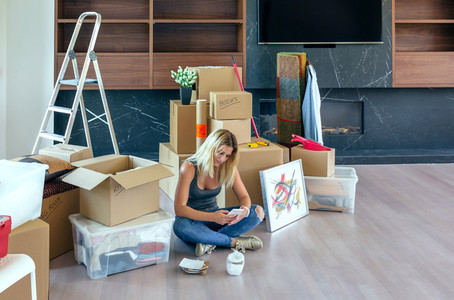 Woman unpacking moving boxes