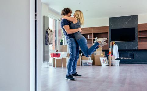Couple hugging in the living room
