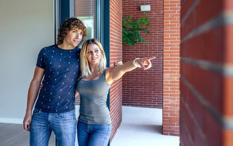 Couple watching new house to buy it