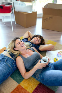 Couple resting lying on the carpet