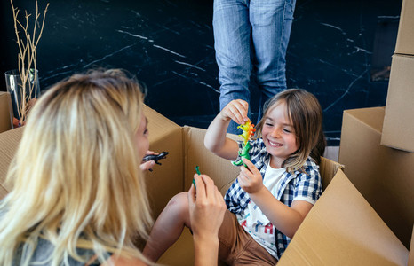 Mother and son playing inside a moving box