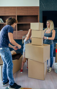 Parents with child helping to make move