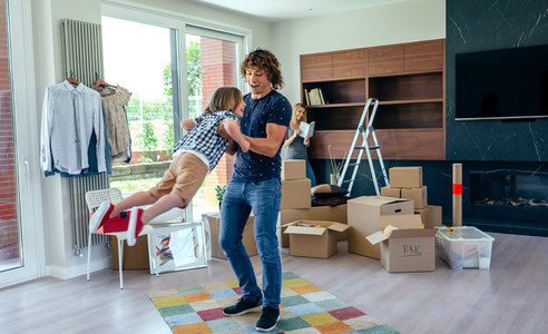 Father and son playing around while preparing the move