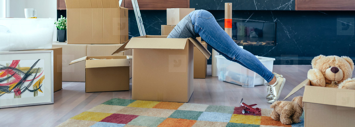 Woman inside a box preparing the move
