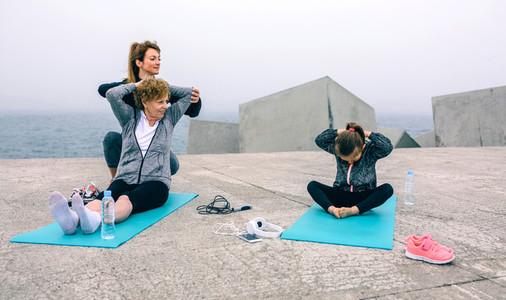 Woman training girl and senior woman