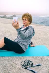 Senior sportswoman taking selfie