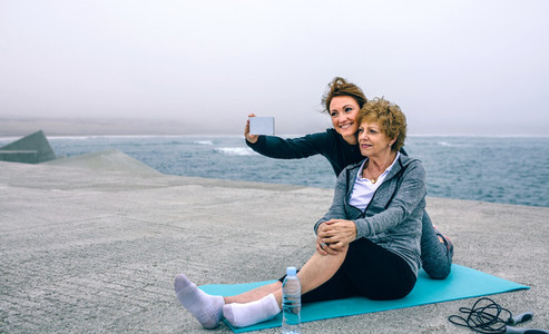 Trainer taking selfie with senior woman