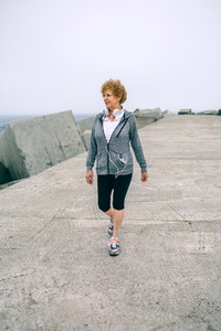 Senior sportswoman walking