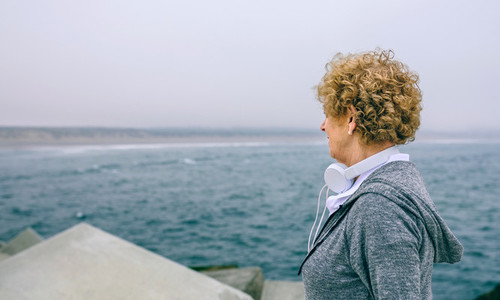 Senior sportswoman looking at the sea