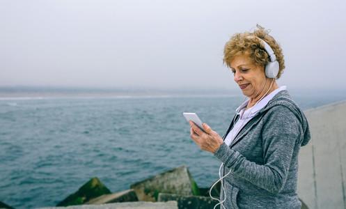 Senior sportswoman looking at her smartphone
