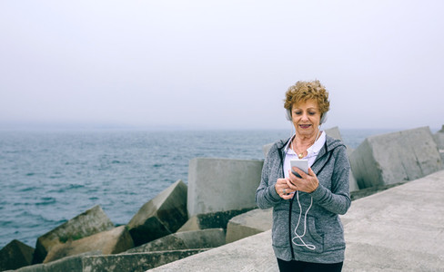 Senior sportswoman looking at her smartphone