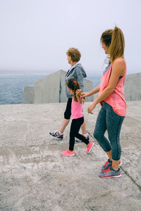 Three female generations walking