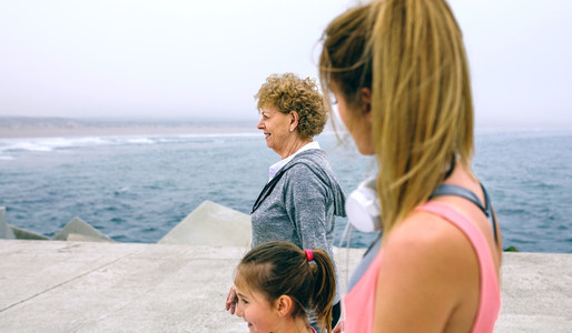 Three female generations walking