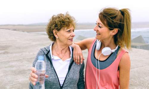 Senior sportswoman talking with female friend