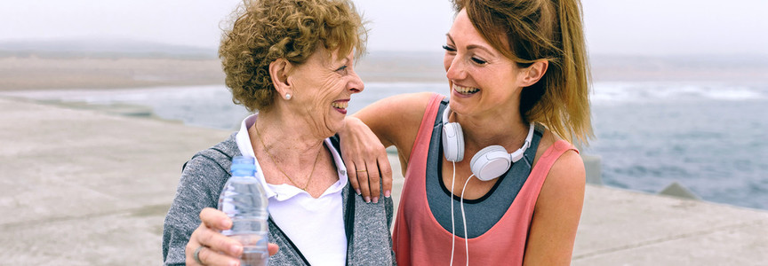 Senior sportswoman laughing with female friend