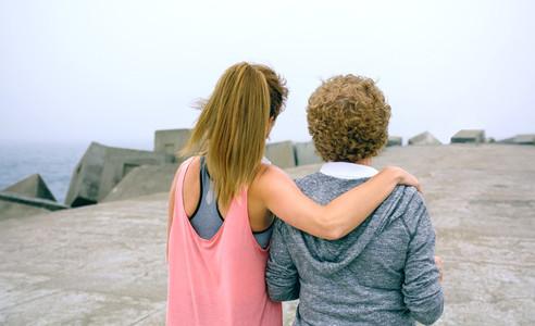 Senior woman and young woman walking