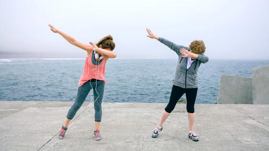 Women making dab dance outdoors