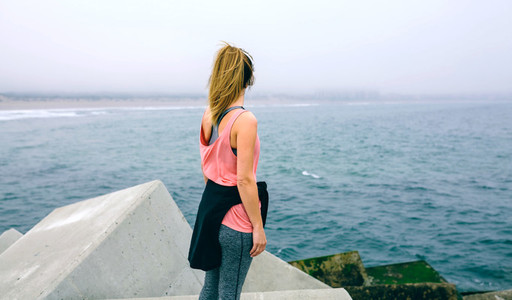 Unrecognizable young woman watching the sea